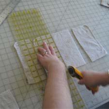 Cutting washcloth into baby wipes