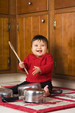 Baby playing with pans