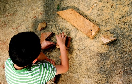 Child playing with wood