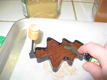 Press cinnamon mixture into molds