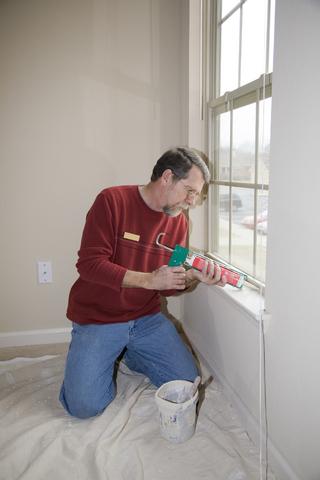 Prevent leaking around windows with caulking