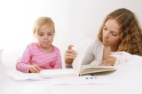 Parent homeschooling child