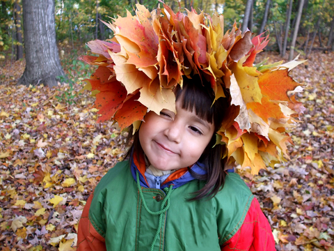 Child wearing fall leaf wreath