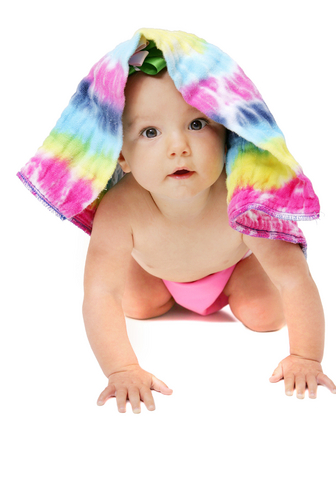 Baby with a tie-dyed prefold cloth diaper