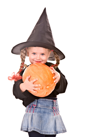 Little girl in witch Halloween costume
