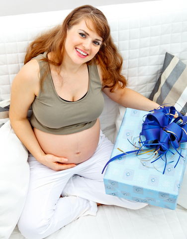 Pregnant woman opening a gift