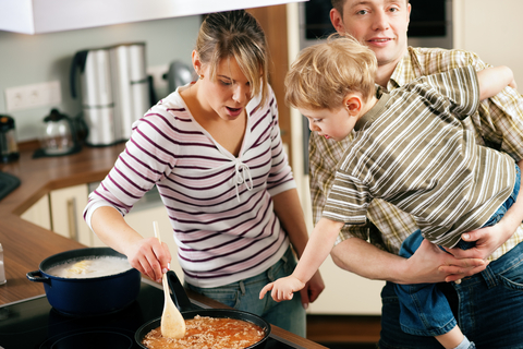Young family making dinner on a budget