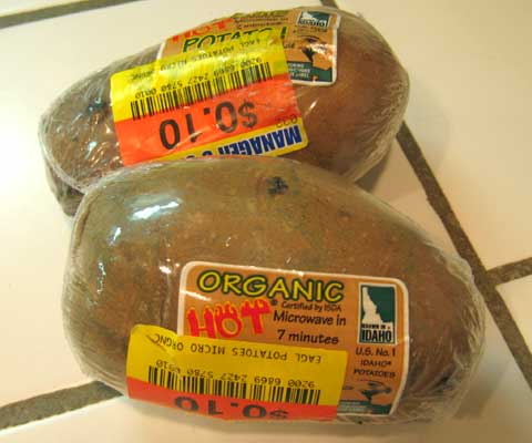 Plastic wrapped organic potato