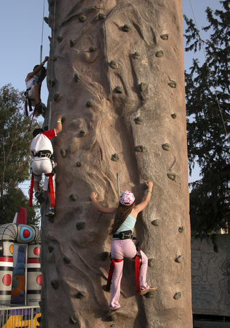 Kids climbing a rock wall