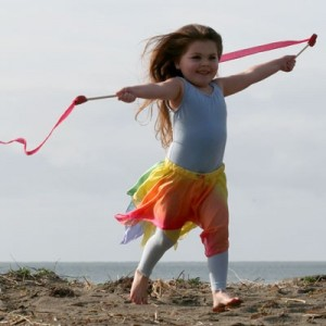 Child dancing with silk streamers