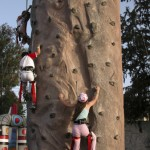 Children on rock climbing wall