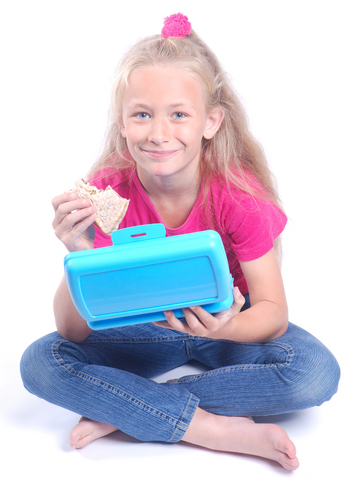 Young girl eating from a luch box