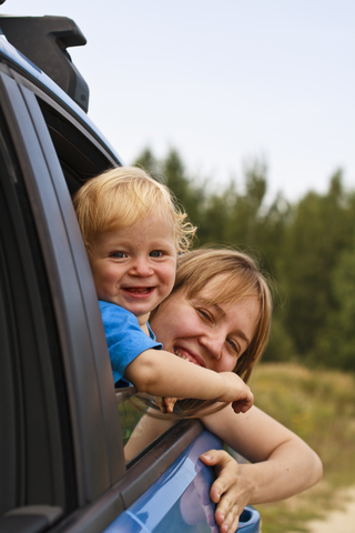 Mother and baby traveling by car