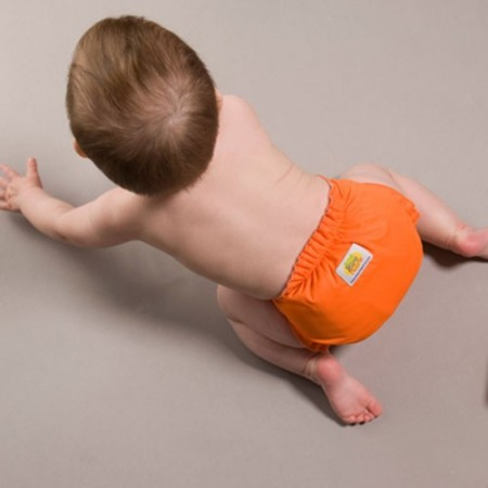 AMP pocket cloth diaper on a crawling baby