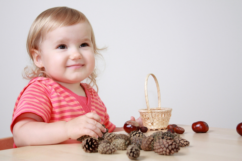 Young child at nature table