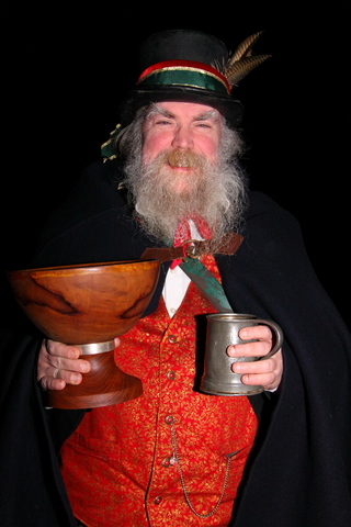 Old man with wassail bowl