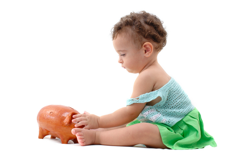 Baby with piggy bank savings