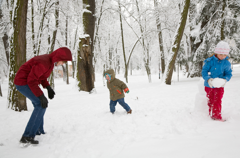 Active family playing in the snow