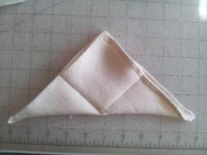 Sew square into doll body