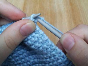Pull knit stitch through loop