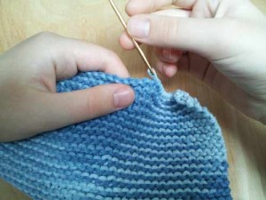 Sew knit ends into cloth
