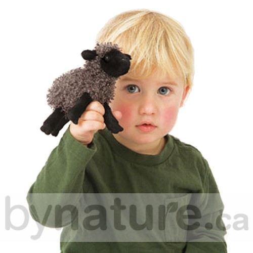 Child with black sheep finger puppet