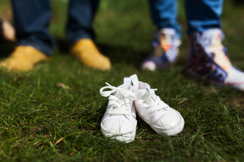 Parents with baby shoes