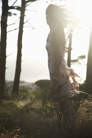 Woman in a breeze in the foreset