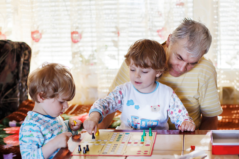Playing board games with grandfather