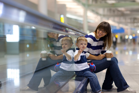 Mother and child waiting for an airplane
