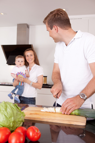 Young family making a meal