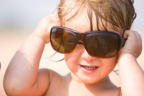 Baby in parent's sunglasses
