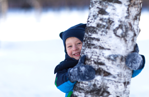Toddler playing outside in the winter