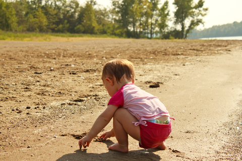 Baby at the beach in summer