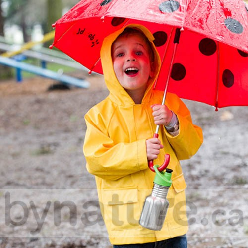 Child in the rain with water bottle