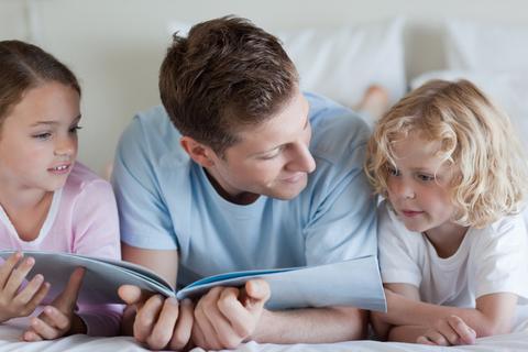Dad reading to children