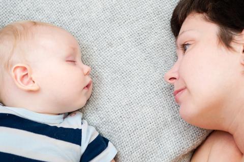 Mother watching sleeping baby