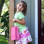 Girl with a birthday party bag