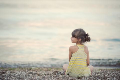 Child sitting quietly