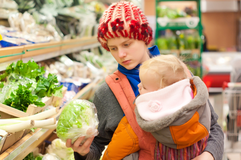 Mother and baby grocery shopping
