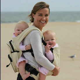 Mother carrying two babies with Moby Wrap