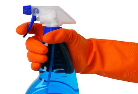 Disinfectant overkill with spray bottle and plastic glove